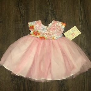 Size 3-6 months baby dress new with tags